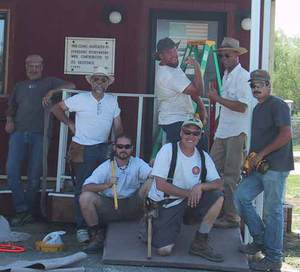 Gerlach residents Vern, Jim, DPW volunteers Eric, Pete, Flynn (DPW and Gerlach resident), Tex, and Gerlach resident John answer a call for construction help from the Gerlach Community Clinic