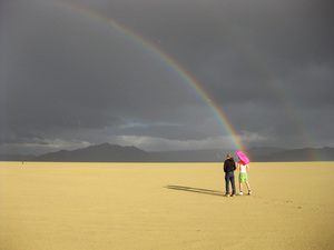 After rainshowers pass through on Monday afternoon, a double rainbow arcs across the playa.