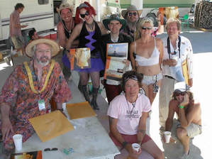 Some of the Burning Man calendar phtographers pose at their annual party in first camp, hosted by CameraGirl.