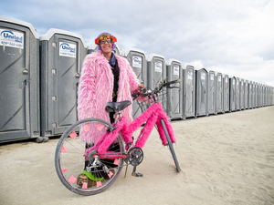 Participant posing in front of a portapotty. (Photo by Mario Covic)
